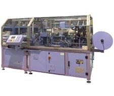 macchine per applicazione maniglie materassi